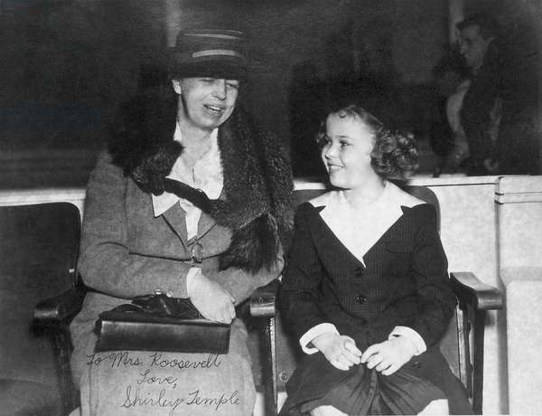 First Lady Eleanor Roosevelt and child star Shirley Temple. July 1938. The photo is autographed, 'To Mrs. Roosevelt, Love, Shirley Temple