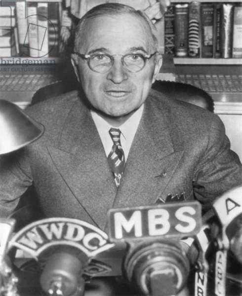 President Harry Truman speaking into microphones of radio networks. c. 1945-48.