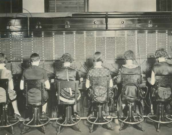 Back view of young women telephone switchboard operations. Washington, D.C., April 7, 1927