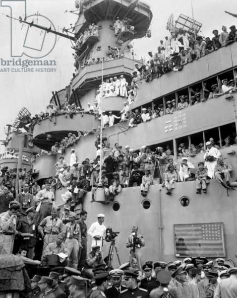 Sailors, spectators, and photographers on the deck of the USS MISSOURI in Tokyo Bay. They will witness the formal Japanese surrender. Sept. 2, 1945. World War 2