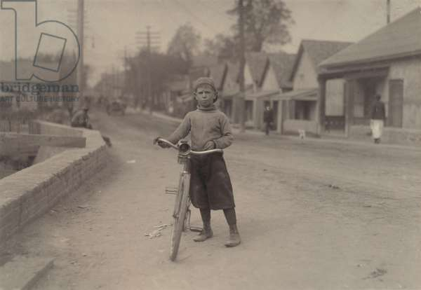 Child labor, Isaac Boyett, 'I'm de whole show', the twelve year old proprietor, manager and messenger of the Club Messenger Service, in the heart of the red Light district where he was delivering messages as he does several times a day. Said he knows the houses and some of the inmates, Texas, photograph by Lewis Wickes Hine, November, 1913