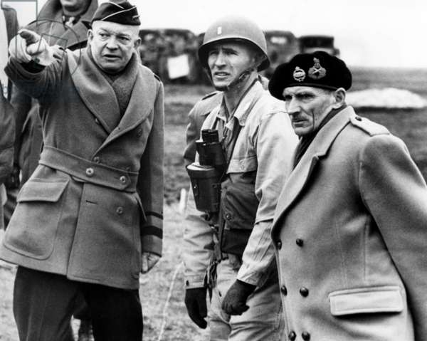 General Dwight D. Eisenhower and Britan's Field Marshall, Bernard Montgomery (far right) confer on the invations plans of Normany in England, 1944