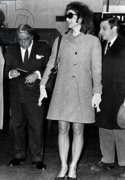 Aristotle Onassis (left), former First Lady Jacqueline Kennedy Onassis (center), arrive in London, England. November 14, 1968