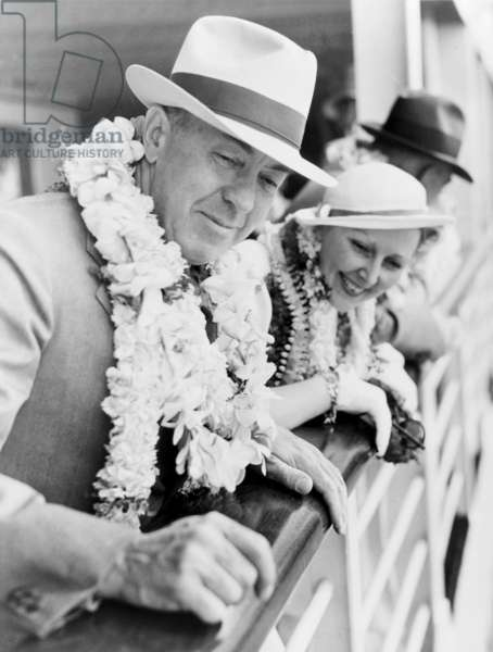 Edgar Rice Burroughs (1875-1950), American author and creator of Tarzan stories, and his wife, leaning over ship's rail as they arrive in Hawaii