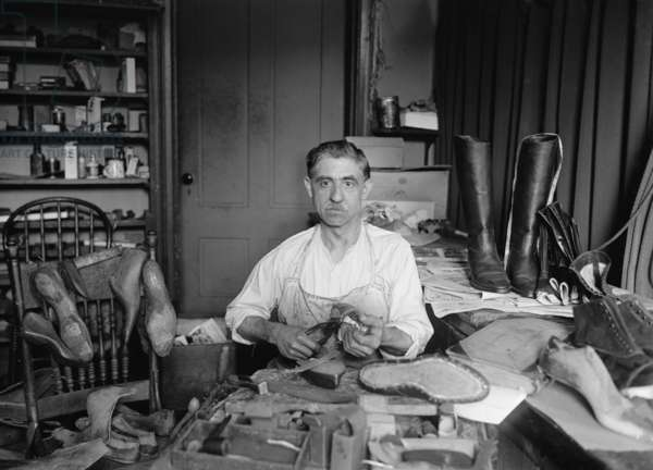 Traditional shoemaker in his workshop is Tony Bruno of Washington, D.C. who made and repaired shoes for presidents and politicians. 1925