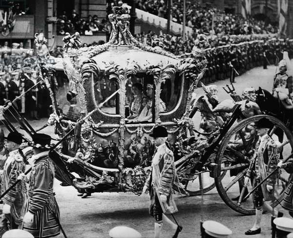 British Royalty. In coach: Queen Elizabeth (future Queen Mother) and King George VI of England, in coronation procession, Trafalgar Square, London, England, May 12, 1937