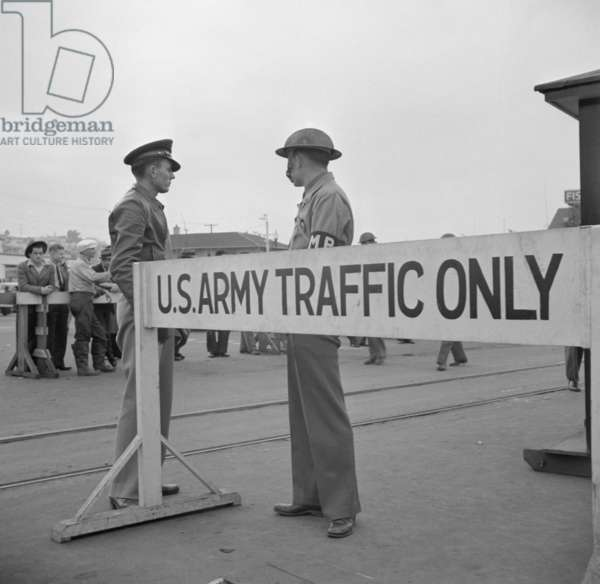Day after Pearl Harbor attack in San Francisco. Army sentries standing guard at transport dock. Dec. 8, 1941