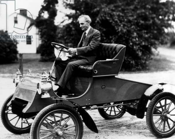 Henry Ford, driving one of his earlier models, the 1903 Mode A Ford Runabout, early 1920s