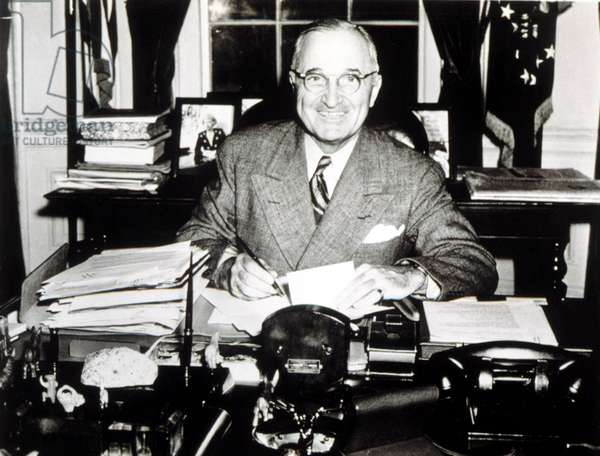 PRESIDENT HARRY TRUMAN working in his White House office, 1946.