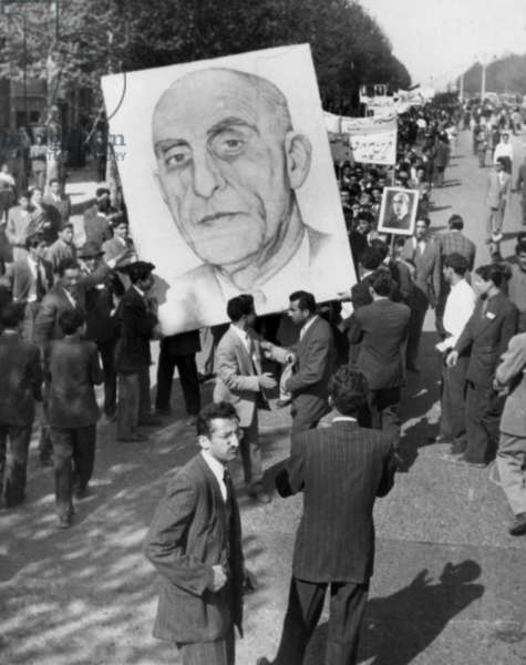 Iranians, demonstrating in favor of the nationalist Premier Mohammed Mossadegh, in 1953. In spite of popular support British-American covert operations prompted an anti-Russian scare campaign that resulted in Mossadegh's disposition