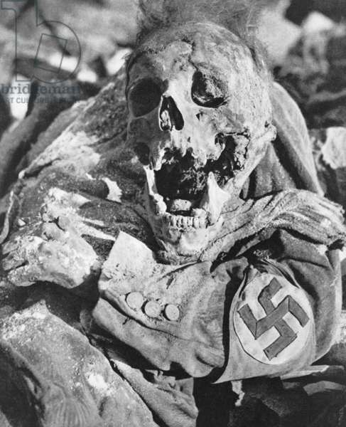Decomposing corpse of man with swastika arm band in Dresden, Germany. Photo by Richard Peter was taken months the Allied World War 2 firebombing. This photograph was published in 1949 in 'Dresden, eine Kamera klagt an' (Dresden, a Photographic Accusation)