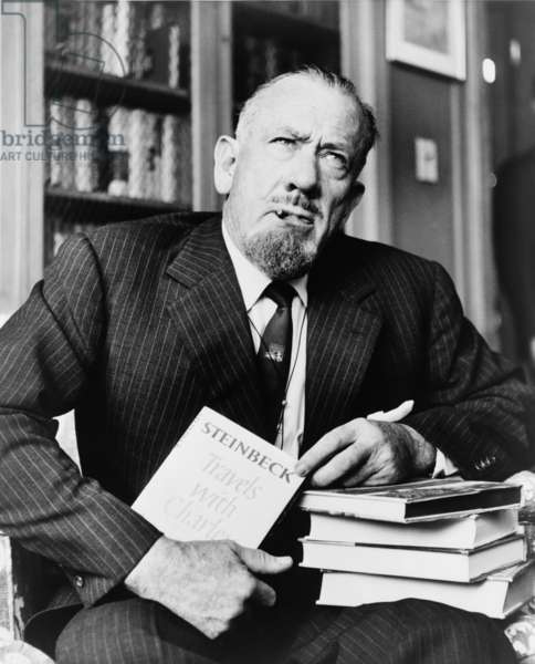 "John Steinbeck (1902-1968), American author who received the Nobel Prize in 1962, holds his most recent book ""Travels with Charley."" 1962"