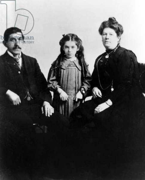 Eva Hart (ctr) was seven when she boarded the Titanic in 1912. Shown here with her parents. She escaped with her mother in a lifeboat. Her father perished in the tragedy, April 15, 1912