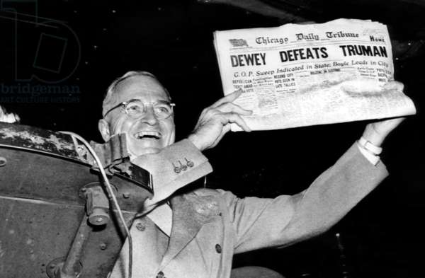 Harry Truman holds up headline that declared Dewey the winner prematurely after Truman won the election, November 1948
