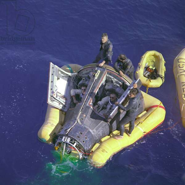 Astronauts Neil Armstrong and David Scott at the close of the Gemini 8 space mission. The mission was interrupted by a malfunction thruster and made an emergency landing in the Pacific Ocean. March 16, 1966