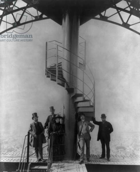 Gustave Eiffel and four others at the summit of the Eiffel Tower, during Paris Exposition. c. 1889