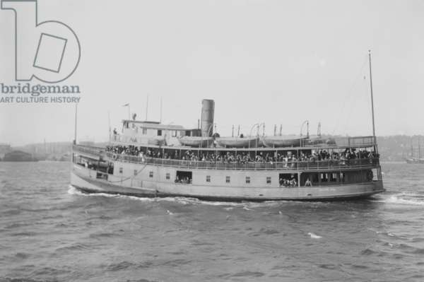 Immigrant ferry boat in New York Harbor. Ferries were used to transfer immigrants from their ocean crossing ships to Ellis Island Immigration Station, and again from Ellis Island to the mainland. c. 1910