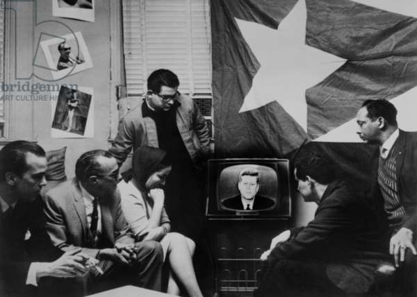Cuban refugees gather watch President Kennedy announcing a 'quarantine' of their home island during the Cuban Missile Crisis. Oct. 22, 1962