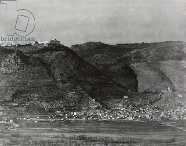 Monte Cassino, the site of the Monastery founded by St. Benedict in the 6th century. Feb. 6, 1944. German soldiers dug in below the Monastery and in Cassino Town below blocked the Allied advance north on Highway 6 to Rome. Feb. 6, 1944. World War 2