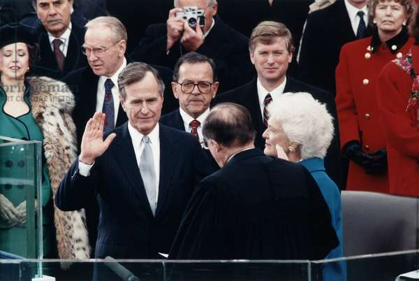 President George Herbert Walker Bush takes the oath of office administered by Chief Justice William Rehnquist. Vice President Dan Quayle and Barbara Bush look on. January 20, 1989