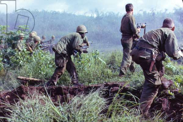 Vietnam War, Dak To, South Vietnam, an infantry patrol moves up to assault the last Viet Cong position after an attempted overrun of the artillery position by the Viet Cong during Operation Hawthorne, c.late 1960s
