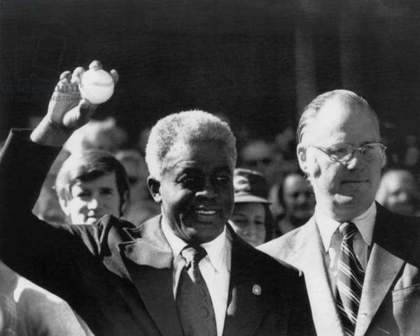 Jackie Robinson and Baseball Commissioner Bowie Kuhn, throwing out the first ball to Game 2 of the 1972 World Series, October 15, 1972