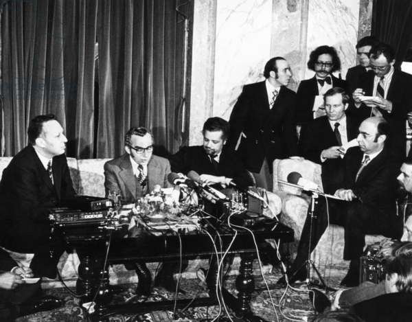 OPEC lifts oil embargo against the United States. Oil Ministers Belaid Abdessalam (Algeria) and Ahmed Zaki Yamani (Saudi Arabia) (with the moustache and beard) announce, through a spokesman (center) that six Arab nations have unconditionally lifted the five month oil embargo against the US. The embargo retaliated against US shipment of arms to Israel during the 1973 Yom Kipper War