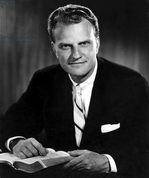 Billy Graham . Evangelist with Bible. Born 11/7/18 in publicity photo from 1964.