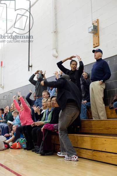 President and Michelle Obama Vice President Joe and Jill Biden react while watching Sasha Obama and Maisy Biden the VP's granddaughter play in a basketball game in Chevy Chase Maryland. Feb. 27 2010.,