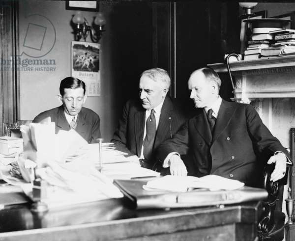 President Warren Harding (1865-1923) with his Vice President, Calvin Coolidge and Postmaster General Will Hayes