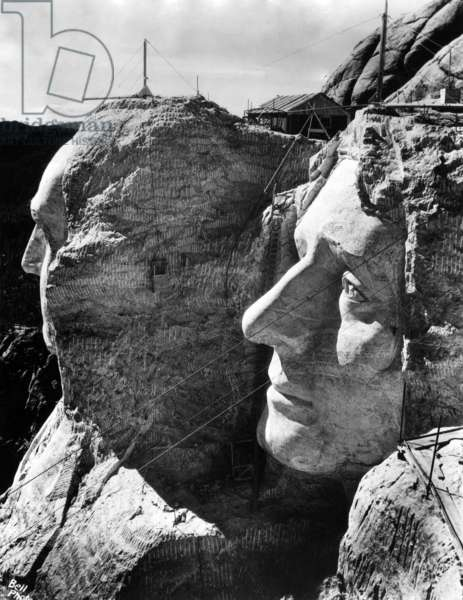 MOUNT RUSHMORE, operations to resume in April after halting for winter. View shows completed profiles of George Washington (l) and Thomas Jefferson (r), South Dakota Black Hills, March 26, 1937
