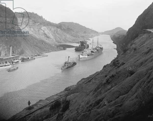 Boats move through Panama Canal at the Culebra Cut (Gaillard Cut), which crosses the continental divide. c. 1915