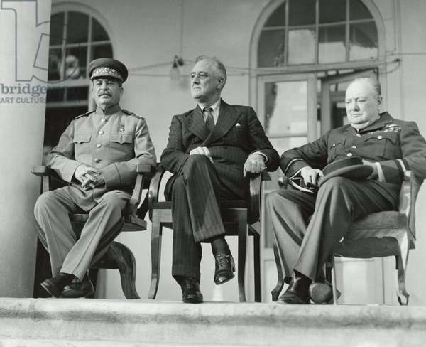 Josef Stalin, Franklin Roosevelt, and Winston Churchill at the WW2 Teheran Conference. It was the first face to face meeting of Franklin and Churchill with Stalin. Nov. 29, 1943