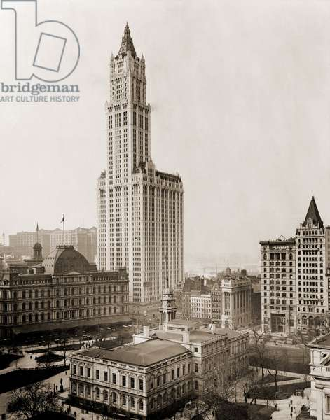 Woolworth Building, the tallest in the world from 1913 to 1930, dwarfs surrounding buildings, New York City. In lower foreground is City Hall. 1913