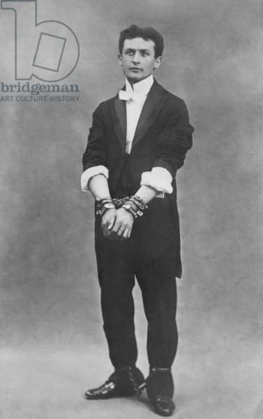 Harry Houdini (1874-1926), in chains. 1903