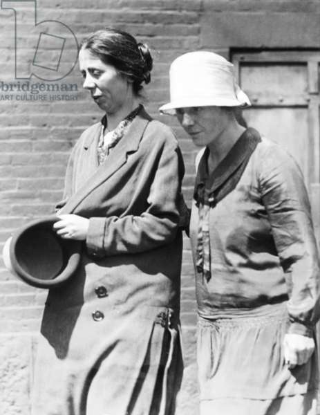 Miss Luigia Vanzetti, (left) is shown leaving the Charlestown State prison with Mrs. Nicola Sacco. Miss Vanzetti is visiting her brother, Bartolomeo in the death house of Massachusetts State Prison, after not seeing him for 19 years. Mrs. Sacco's husband is in the same death house awaiting execution for the murder of a South Braintree shoe factory paymaster and a guard in 1925. c. Aug. 1, 1927. -