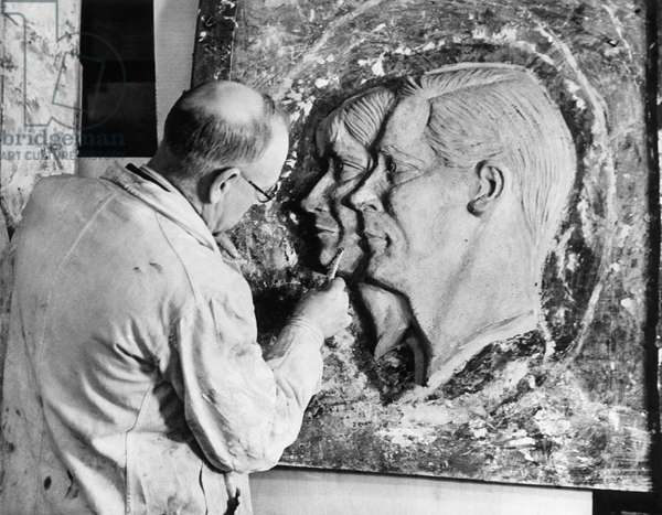 Sculptor changing the head of a statue of the abdicated King Edward VIII into a likeness of King George VI, and his wife Queen Elizabeth, the former Duchess of York, for the coronation, England, December 23, 1936