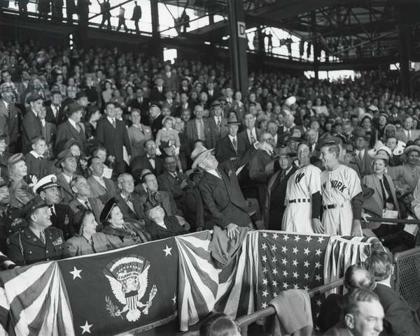 President Harry Truman tosses a baseball from the stands to open the season, 1948