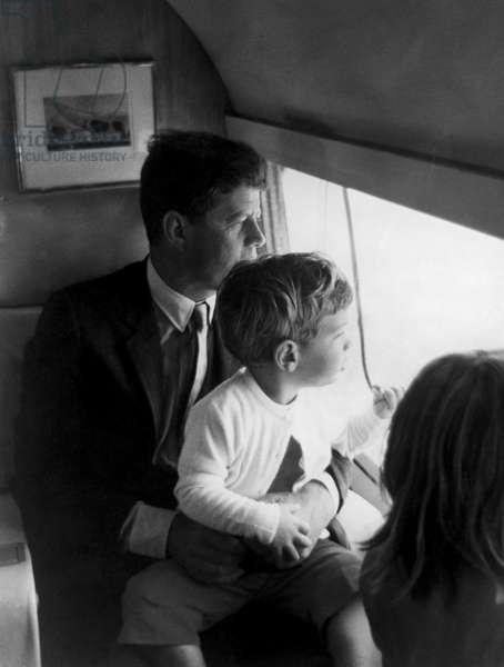 John F. Kennedy, John F. Kennedy Jr. looking out of airplane window