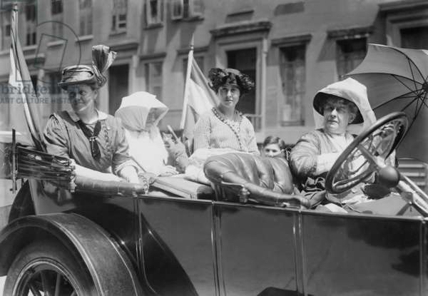 Women's suffrage leaders in an open car at a Votes for Women parade in New York City. Photo shows Susan Walker Fitzgerald, Emma Bugbee, Maggie Murphy, and Harriot Stanton Blatch. Blatch was the daughter of 19th century women's rights leader Elizabeth Cady Stanton. July 30, 1913