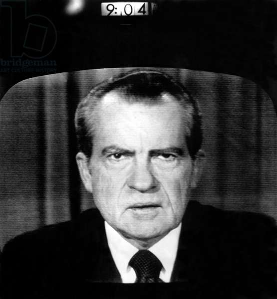 President Richard Nixon, with digital clock indicating the exact minute he resigned the Presidency, 08/08/74