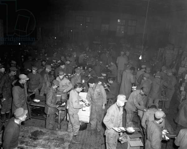 5th U.S. Marine Regiment has Thanksgiving dinner of turkey, pumpkin pie and trimmings, Nov. 23, 1950. Outside was the bleak, icy wilderness of Hagaru-ri, North Korea, with Chinese Communist 'People's Volunteer Army' bearing down on them. Korean War, 1950-53