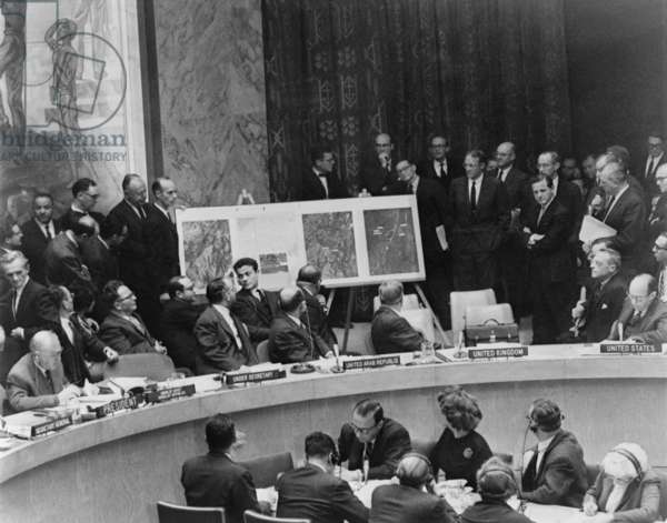 Adlai Stevenson describes location of missile sites in Cuba using aerial photographs during a United Nations Security Council meeting in New York. October 25, 1962