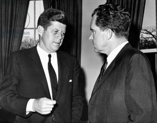 President John Kennedy confers with former Vice President Richard Nixon. They had a 75 minute meeting to discuss the Cuban Crisis caused by the failed Bay of Pigs invasion. April 20, 1961