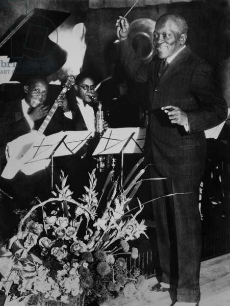 Jack Johnson, Flamboyant African American heavyweight. In 1931 the retired boxing champion conducting the orchestra in his newly opened Los Angeles nightclub 'The Showboat'