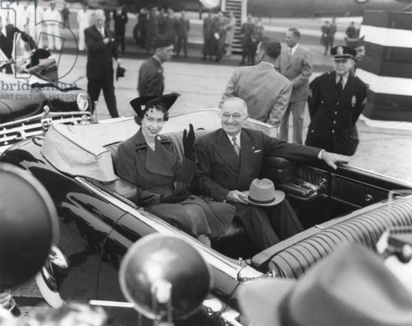 President Harry S. Truman rides with Princess Elizabeth in an open limousine. Princess Elizabeth and the Duke of Edinburgh took the place of ailing King George VI on a tour of Canada and the United States in autumn 1951. Oct. 31, 1951.