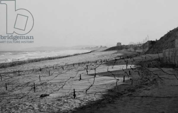 German barbed wire obstacles on the beach at Franceville, Brittany, France. 1944. World War 2