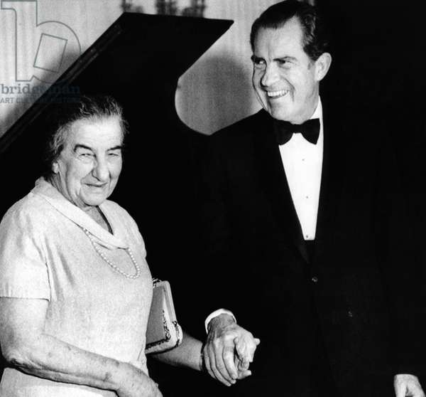 President Richard Nixon and Israeli Prime Minister Golda Meir hold hands following a White House dinner. March 1, 1973
