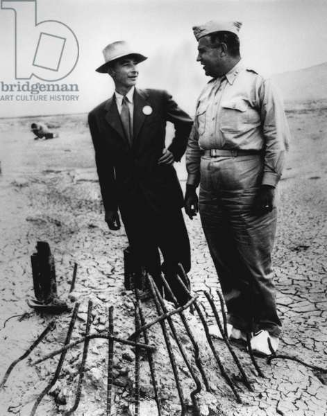 Gen. Leslie Groves (r) and Dr. J. Robert Oppenheimer at Trinity Test Site in Sept. 1945. They examine the remains of the tower from which the first manmade atomic explosion was detonated near Alamogordo, New Mexico