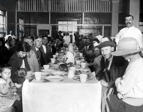 NEW YORK: This was Ellis Island in 1923. Immigrants awaiting approval of their entry into the U.S. crowd the lunchroom for their noonday meal.